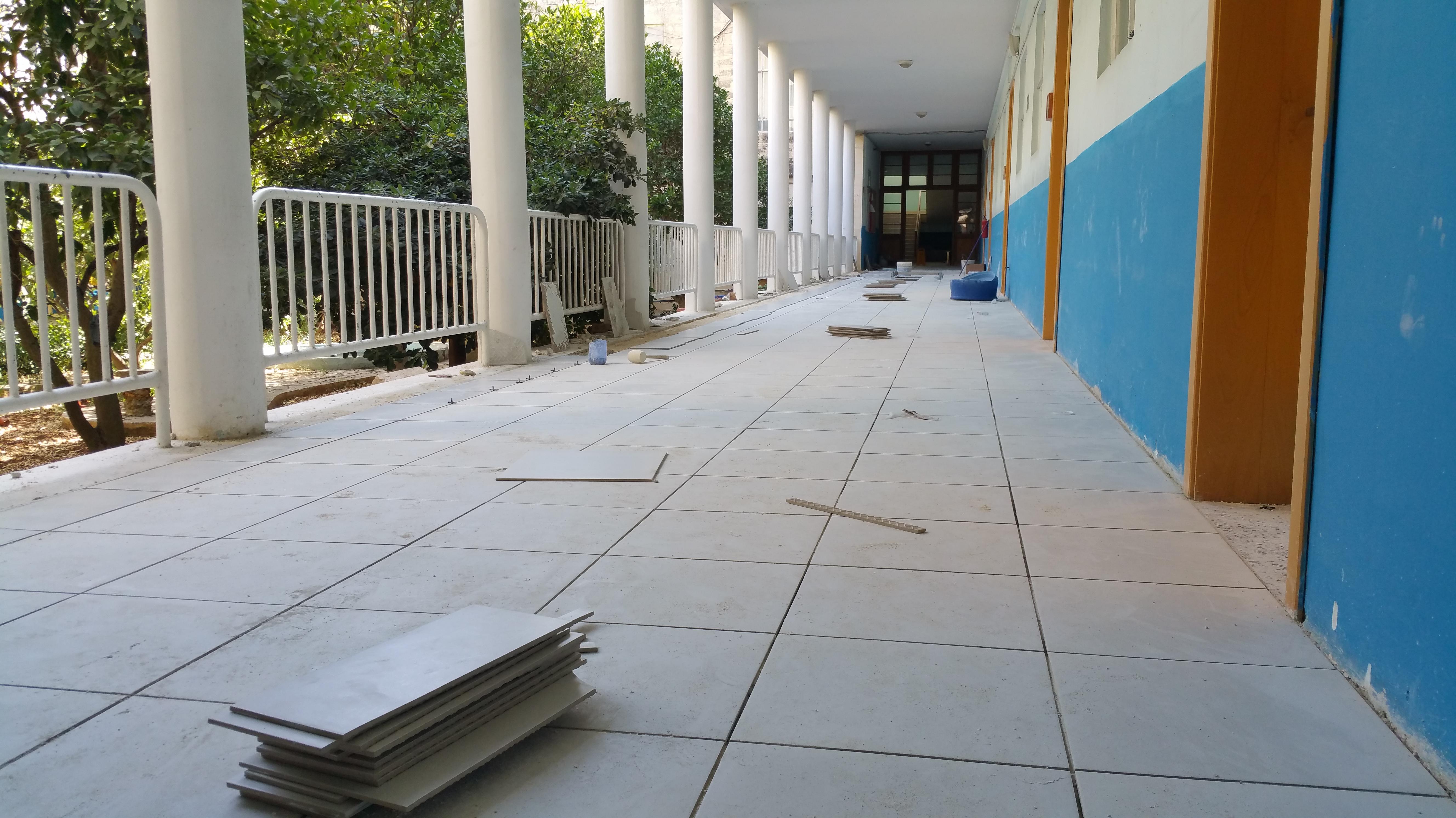 New tiling in ground floor corridor